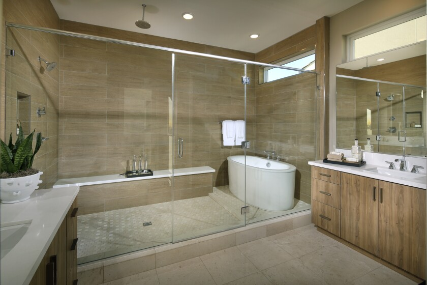 A spacious master bathroom at Pardee Homes' neighborhood of Carmel in Pacific Highlands Ranch showcases a modern aesthetic and spa-like features.