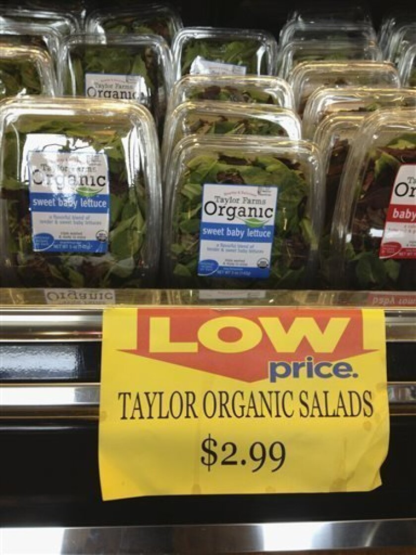 File - In this Aug. 3, 2013, file photo are packages of Taylor Farms salads for sale at a supermarket in Omaha, Neb. Salinas, Calif.-based Taylor Farms announced Monday, Aug. 12, 2013, that Taylor Farms de Mexico has stopped production of salad mix and leafy greens at its facility that have been linked to an outbreak of stomach illnesses in Iowa and Nebraska. Production has been shifted to crops and processing facilities in the United States. (AP Photo/Nati Harnik, File)