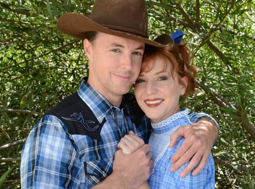 "Allen Everman and Kailey O'Donnell star as Curly and Laurey in Welk Resorts Theatre's staging of Rodgers & Hammerstein's ""Oklahoma!"""