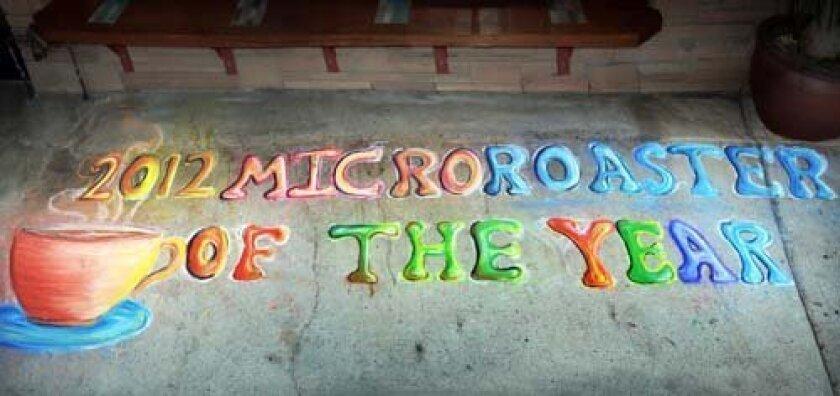 Chalk art by Eric Haerr proclaims the award.