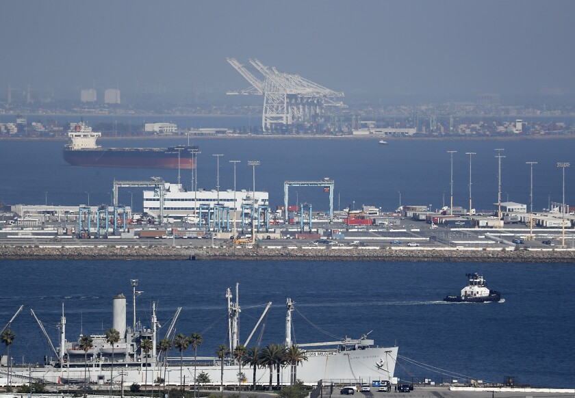 Empty berths and idle cranes at the ports of Los Angeles and Long Beach on March 6.
