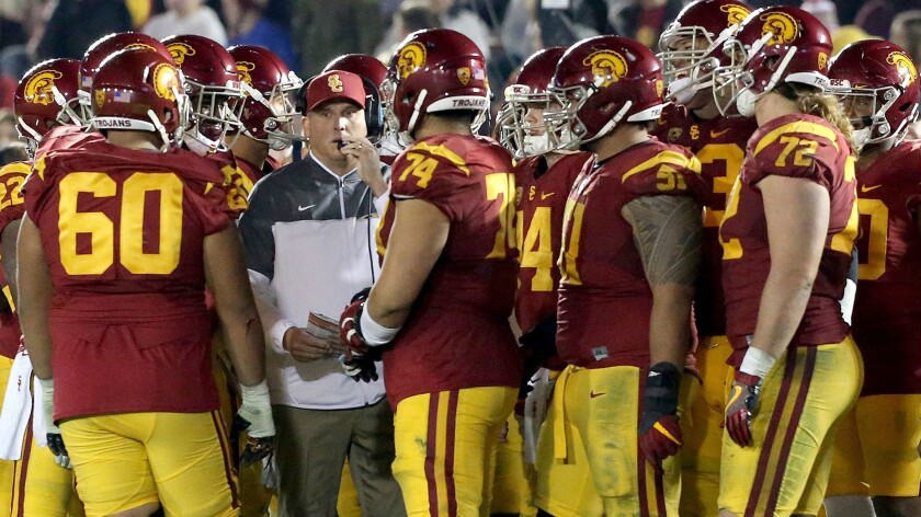 USC coach Clay Helton during a timeout with players.