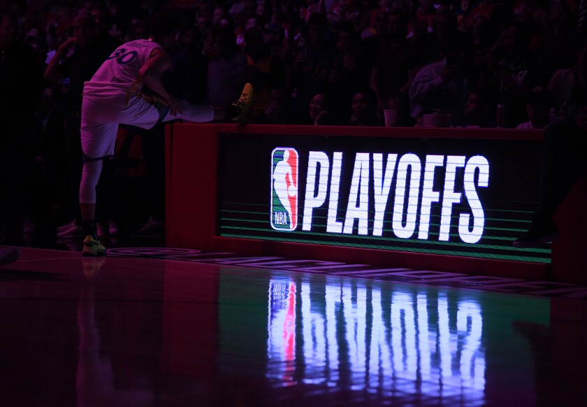Golden State guard Stephen Curry stretches before a playoff game against the Clippers at Staples Center on April 18, 2019.