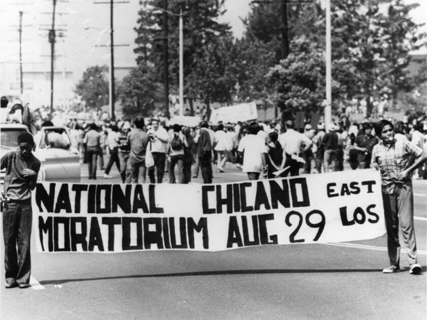 Two young men hold a banner marking the National Chicano Moratorium in East Los Angeles on Aug. 29, 1970.
