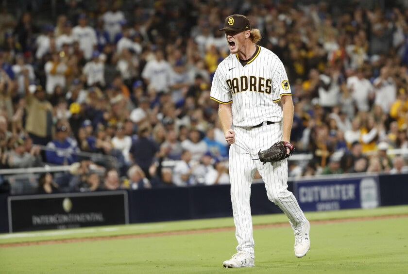 Padres reliever Mason Thompson celebrate against the Dodgers in the eight inning on Tuesday, June 22, 2021 in San Diego.