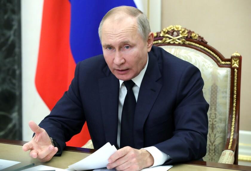 Russian President Vladimir Putin leads a meeting via video conference in Moscow, Russia, Monday, Feb. 1, 2021. (Mikhail Klimentyev, Sputnik, Kremlin Pool Photo via AP)