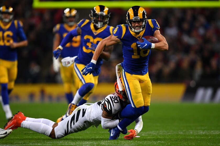 Rams receiver Cooper Kupp is tackled by Bengals defensive back Jessie Bates after one of his seven receptions Sunday at Wembley Stadium.