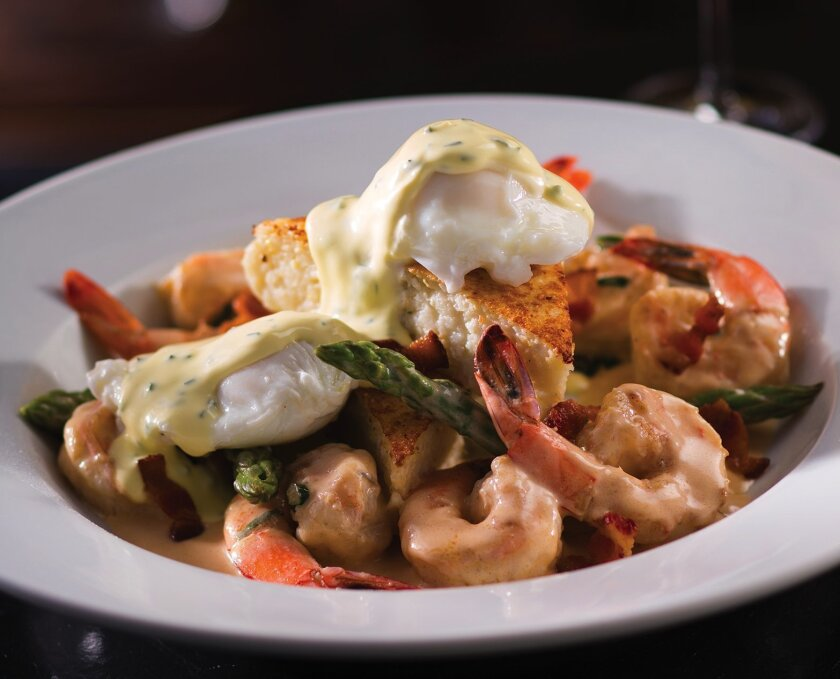 The adult menu at Eddie V's features bananas foster French toast, steak and eggs benedict, seafood chopped salad and shrimp and grits (pictured above).