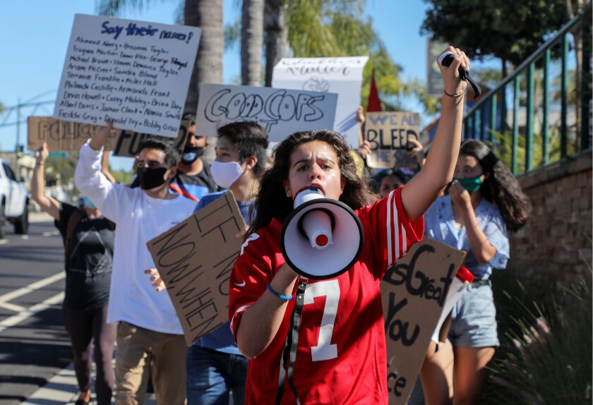 June 9, 2020_Encinitas, California, USA_| Martha Contreras speaks into a bullhorn as she leads a late afternoon Black Lives Matter protest north on Coast Highway 101. |_Photo Credit: Photo by Charlie Neuman