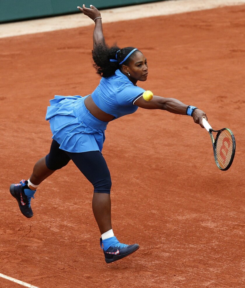 Serena Williams of the U.S. returns the ball to Spain's Garbine Muguruza during their final match of the French Open tennis tournament at the Roland Garros stadium, Saturday, June 4, 2016 in Paris.  (AP Photo/Christophe Ena)