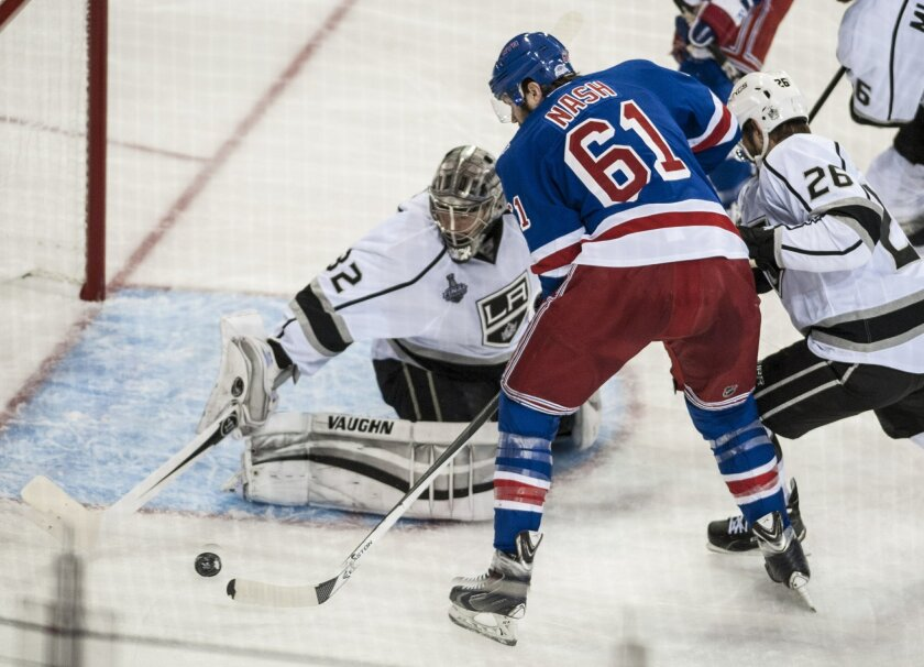 RTick Nash of the Rangers takes a shot on Jonathan Quik in the second period as the Los Angeles Kings play the New York Rangers in Game 4 of the Stanley Cup Finals Wednesday night June 11, 2014 at Madison Square Garden in New York. (AP Photo/The Orange County Register, Mark Rightmire)