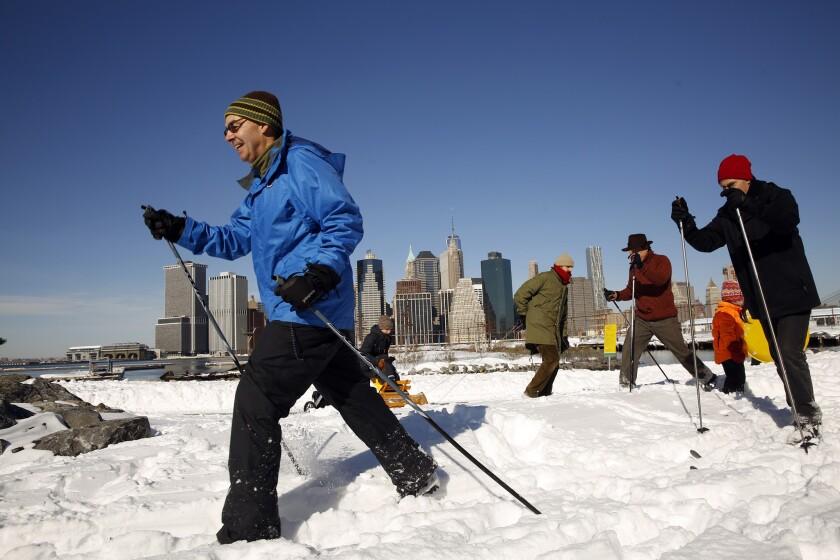 People enjoy cross-country skiing along the waterfront in Brooklyn, N.Y.
