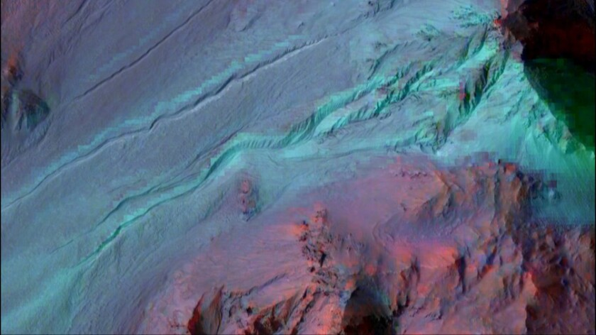 The highly incised gullies on the eastern rim of the Hale crater on Mars appear to have been carved by liquid water. However, no hydrated minerals were seen within the gullies in the CRISM image.