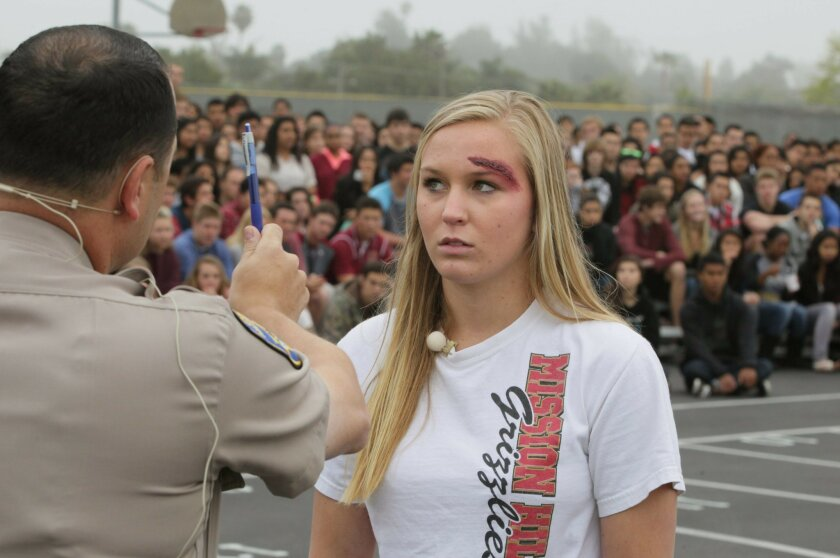 During the mock accident scene, junior Kendyl Mundt was questioned by a CHP officer.