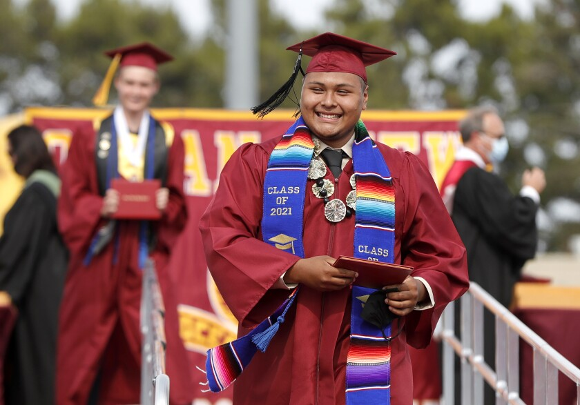 Joseph Espinoza wears a smile of pride after accepting his diploma during the Ocean View High graduation ceremony.