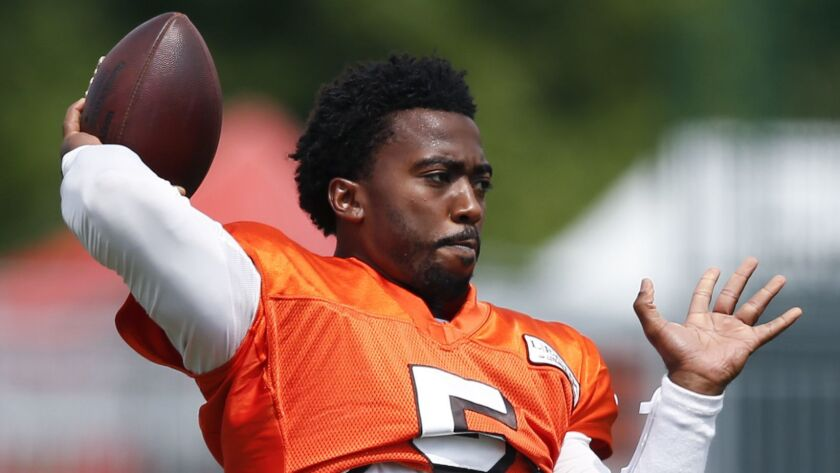 Cleveland Browns quarterback Tyrod Taylor warms up during NFL football training camp Sunday, Aug. 12