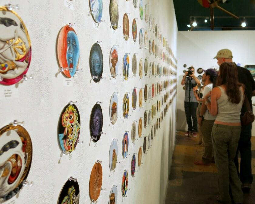 At La Luz de Jesus Gallery, beer coasters converted into art pieces are on display.