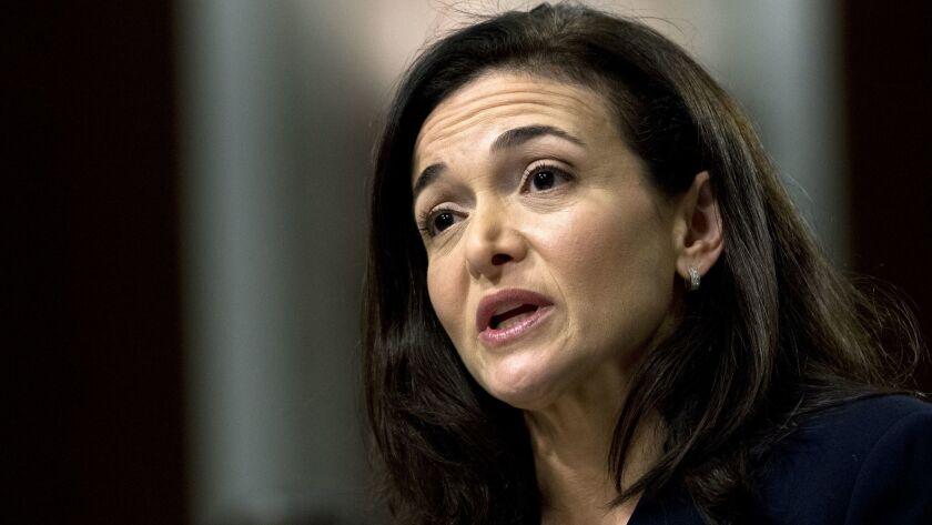 FILE- In this Sept. 5, 2018, file photo Facebook COO Sheryl Sandberg testifies before the Senate Int