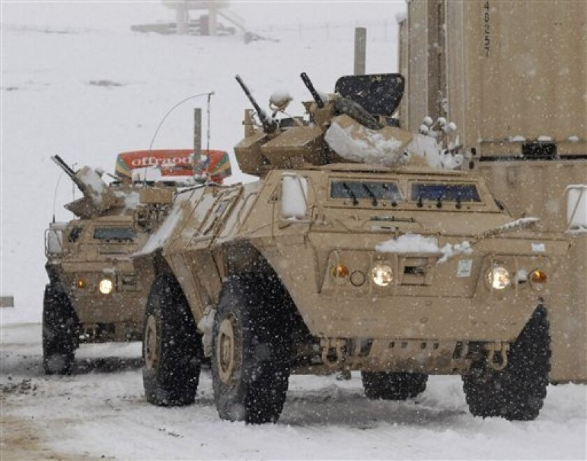 In this photo provided by the International Security Assistance Force (ISAF), Armored Security Vehicles move into Forward Operating Base Shank as part of a four-hour convoy that carried soldiers of the 3rd Brigade Combat Team from Bagram Air Field to the the FOB in the Logar province of Eastern Afg