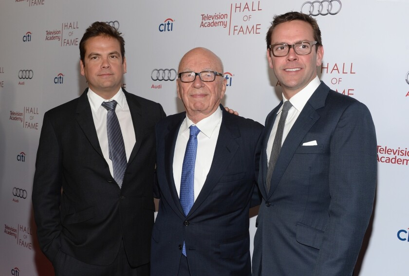 Lachlan Murdoch, left, Rupert Murdoch and James Murdoch attend the Television Academy's 23rd Hall of Fame Induction Gala on March 11, 2014, in Beverly Hills.