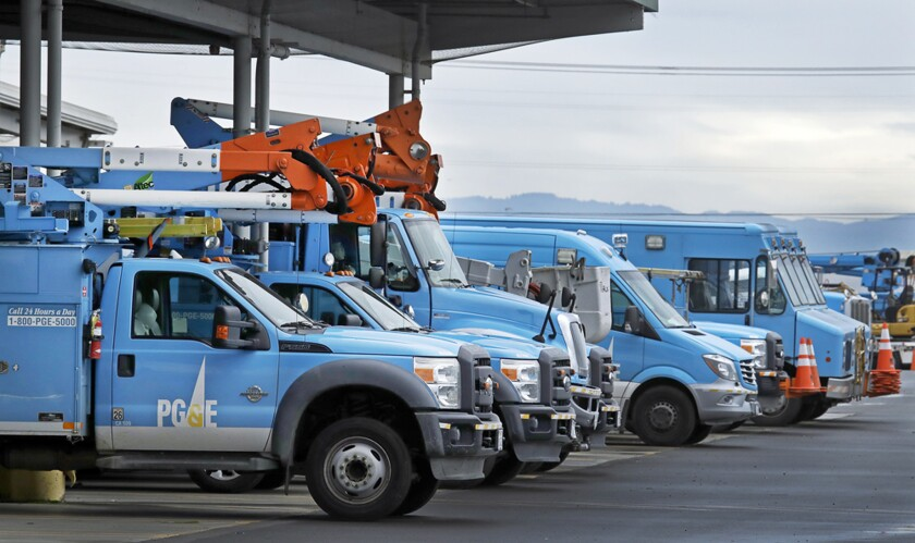Pacific Gas & Electric vehicles parked at the utility's Oakland Service Center in January.