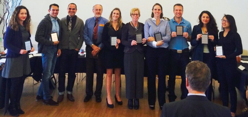 Winners of the La Jolla Village Merchants Association's Holiday Festival of Lights competition receive awards during the association's Jan. 14 meeting: Claudette Berwin (Gallery Properties), Esteban Lopez and James Niebling (Esteban Interiors), Larry Combe (Bowers Jewelry), Erin Figi (Harcourts Pre