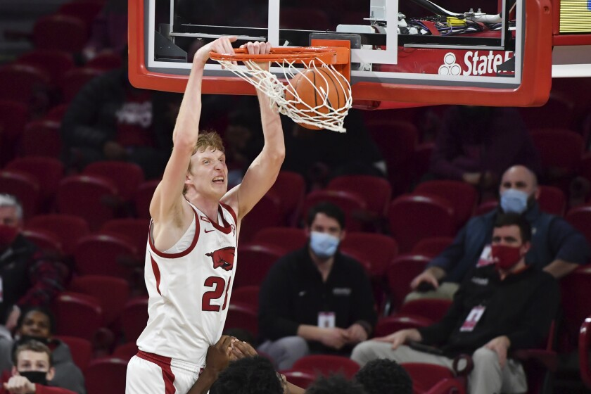 Arkansas forward Connor Vanover dunks against Mississippi State during the second half of an NCAA college basketball game Tuesday, Feb. 2, 2021, in Fayetteville, Ark. (AP Photo/Michael Woods)