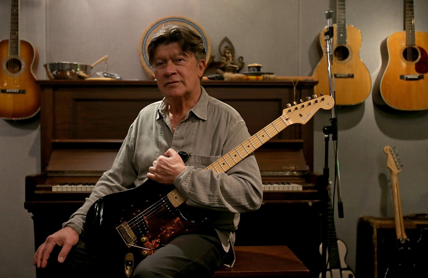 Robbie Robertson, lead guitarist for the Band, holds a recent incarnation of the Fender Stratocaster electric guitar, a music industry standard that is celebrating its 60th anniversary this year.