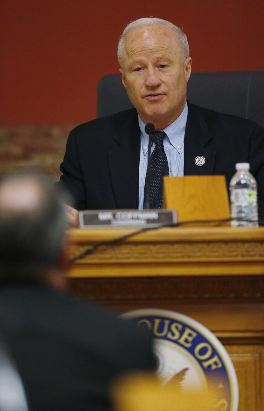 U.S. Rep. Mike Coffman,R-Colo , back, directs a question to a witness during a House Veterans Affairs subcommittee field hearing on VA hospitals and prescription drugs for veterans Friday, May 20, 2016, in the State Capitol in Denver. The House subcommittee heard from three Colorado-based VA officials during the field hearing. (AP Photo/David Zalubowski)