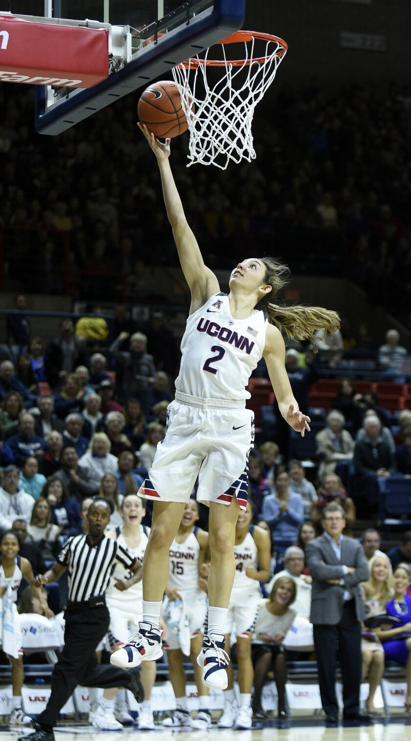 Connecticut's Briana Pulido (2) scores during the second half of Connecticut's 92-46 victory over East Carolina in an NCAA college basketball game in Storrs, Conn., on Saturday, Feb. 6, 2016. (AP Photo/Fred Beckham)