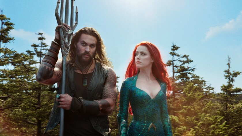 This image released by Warner Bros. Pictures shows Jason Momoa, left, and Amber Heard in a scene fro