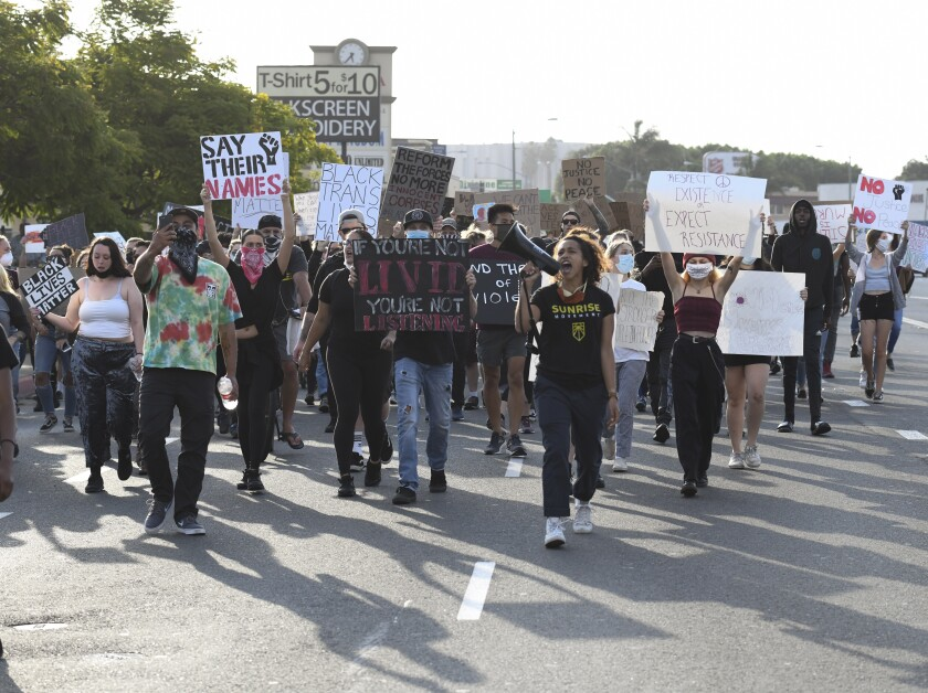 Protesters march down Sport Arena Blvd. during a Black Lives Matter protest Wednesday, June 3, 2020 in San Diego.