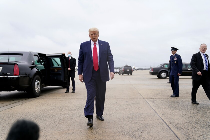 President Donald Trump walks towards the media to speak before boarding Air Force One for a trip to Kenosha, Wis., Tuesday, Sept. 1, 2020, in Andrews Air Force Base, Md. (AP Photo/Evan Vucci)