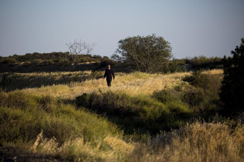Berggruen walks along a peak on the 450 acres he purchased in the Sepulveda