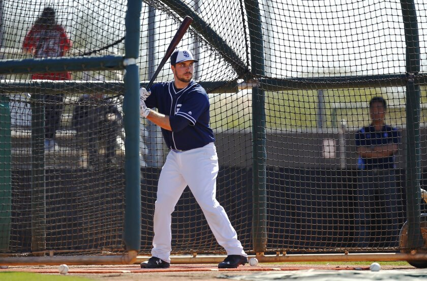 San Diego Padres catcher Austin Hedges bats during practice at spring training.