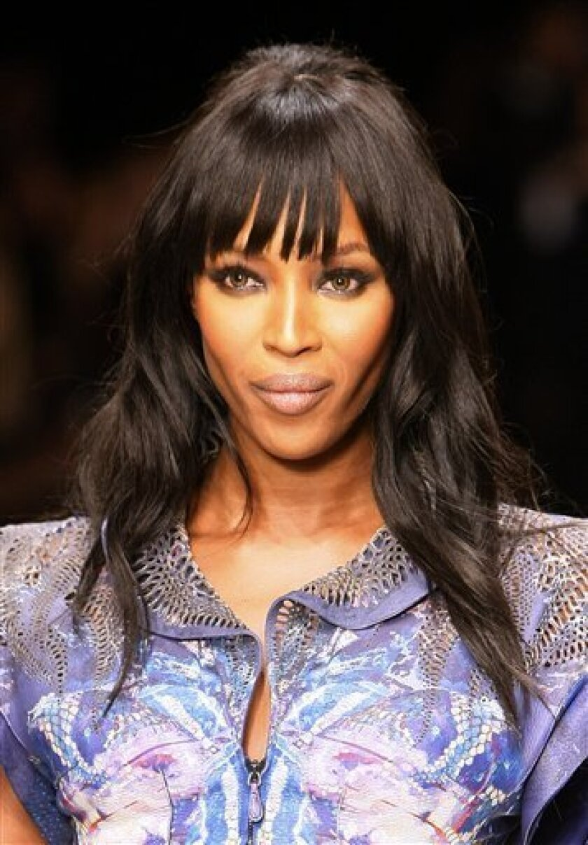 FILE - In this Feb. 18, 2010 file photo, model Naomi Campbell takes part in Naomi Campbell's Fashion for Relief-Haiti show in London. (AP Photo/Alastair Grant)