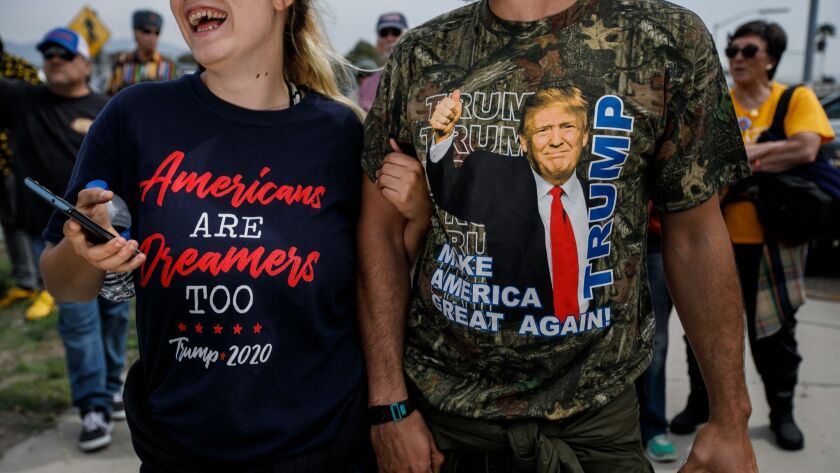 SAN DIEGO, CALIF. -- TUESDAY, MARCH 13, 2018: Counter protesters sport political attire during Presi