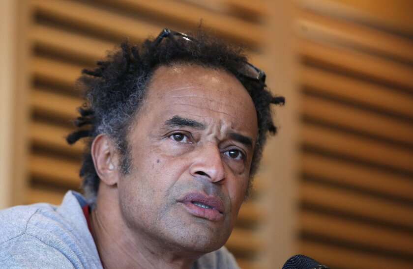 Newly named French Davis Cup team head coach Yannick Noah answers journalists during a press conference in Paris, Wednesday,  Feb.17, 2016. France will face Canada in the Davis Cup first round next March 4-6. (AP Photo/Thibault Camus)