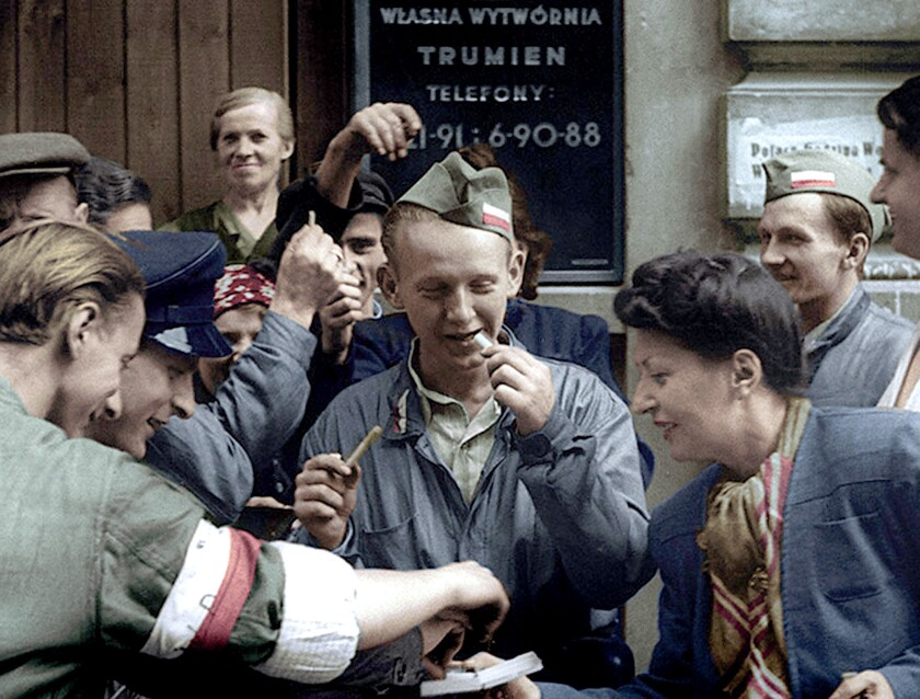 """A woman hands smokes in """"Warsaw Uprising,"""" a hybrid documentary-narrative feature about the ill-fated 1944 rebellion against the Nazis, using edited silent footage that had color and dialogue added."""