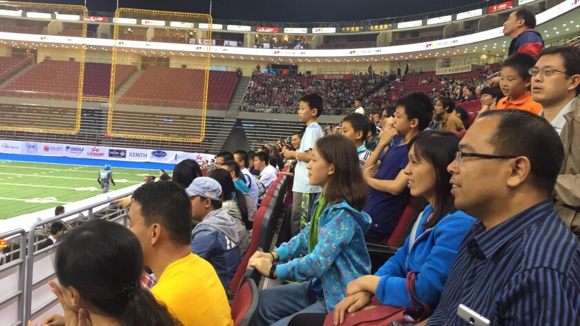 A crowd watches the Dalian Dragon Kings play the Shenzhen Naja in China's first professional football league.