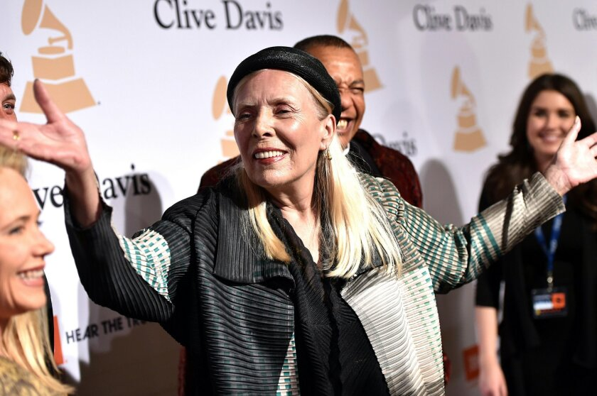 Joni Mitchell arrives at the 2015 Clive Davis Pre-Grammy Gala at the Beverly Hilton Hotel on Saturday, Feb. 7, 2015, in Beverly Hills, Calif.