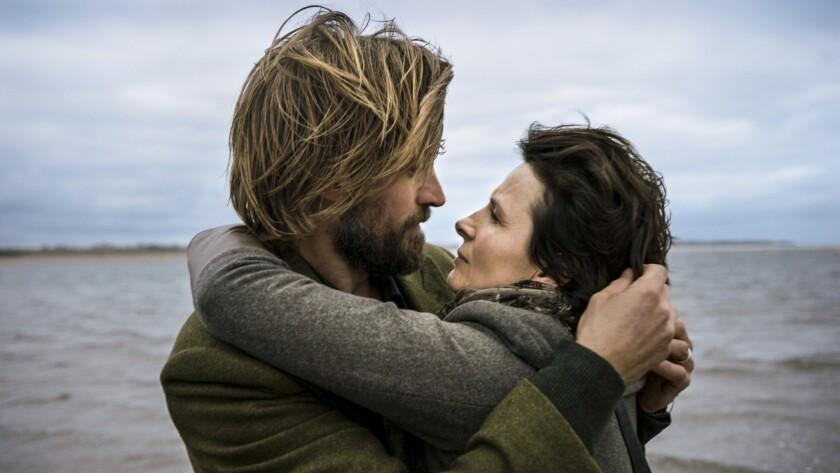 "Nikolaj Coster-Waldau and Juliette Binoche in ""1,000 Times Goodnight."""