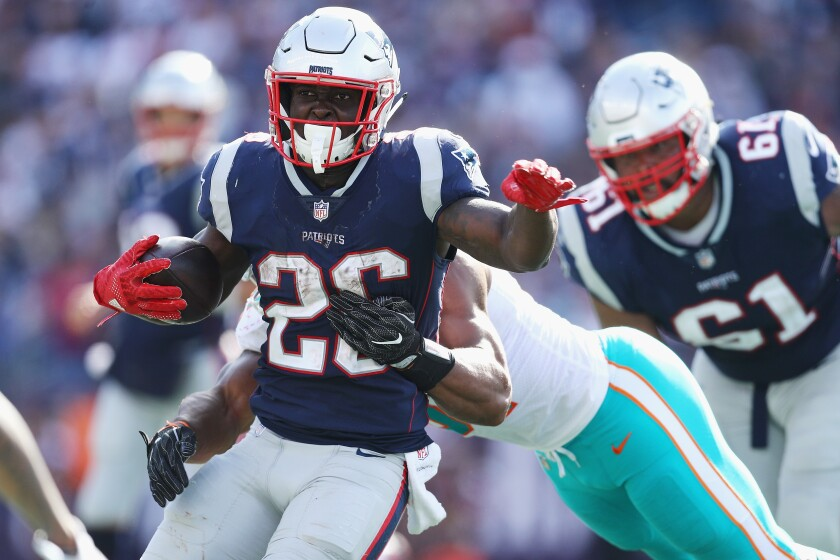 Sony Michel (26) of the New England Patriots runs with the ball during the second half against the Miami Dolphins at Gillette Stadium on September 30, 2018 in Foxborough, Massachusetts. Michel's dominance during last season's postseason run could be a preview of a breakout season.