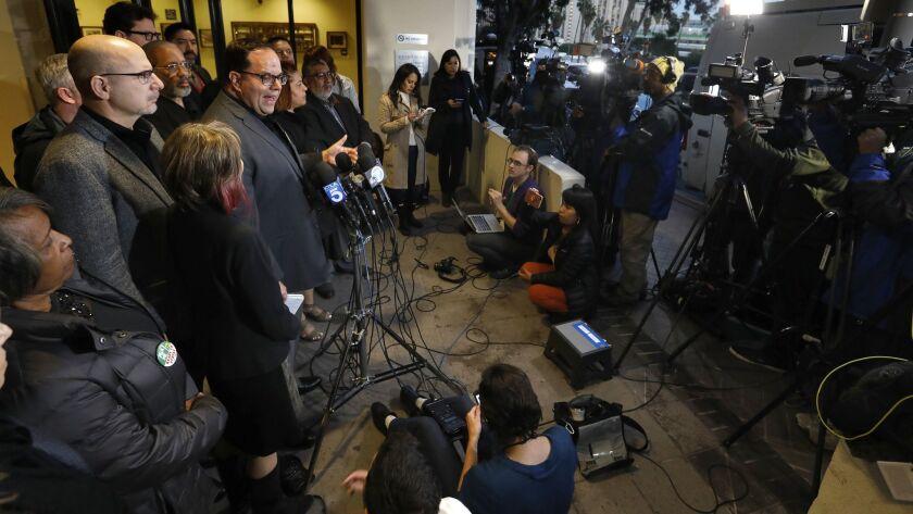 Alex Caputo-Pearl, president of United Teachers Los Angeles, talks to reporters.