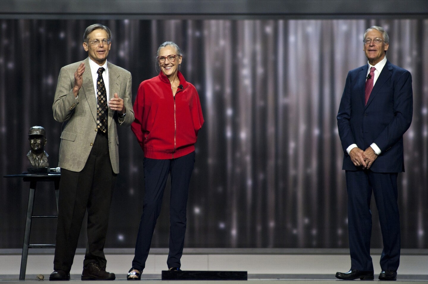 No. 10: Jim Walton, left, the youngest son of Wal-Mart founder Sam Walton, sharing the stage with siblings Alice Walton and Rob Walton, had a net worth of $34.7 billion.