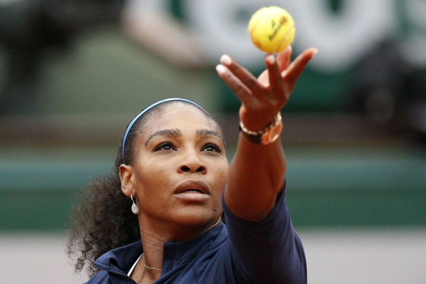 Serena Williams of the U.S. serves the ball to Ukraine's Elina Svitolina during their fourth round match of the French Open tennis tournament at the Roland Garros stadium, Wednesday, June 1, 2016 in Paris.  (AP Photo/Christophe Ena)