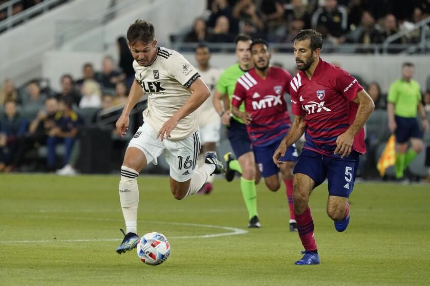 LAFC forward Danny Musovski, left, dribbles past Dallas FC's Quignon