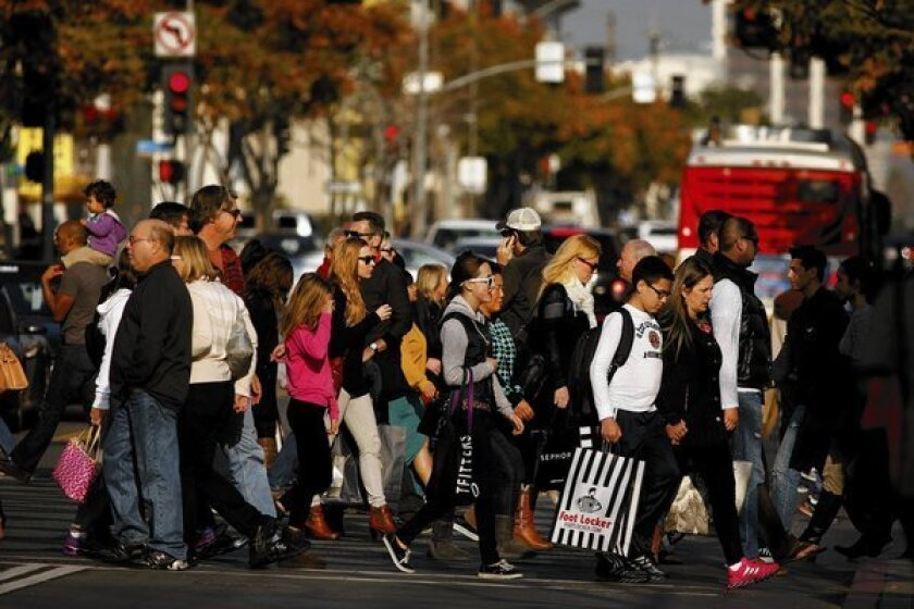 Shoppers brave the Third Street Promenade crowds on Super Saturday in Santa Monica.