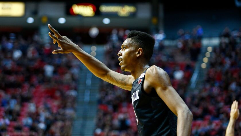 SDSU forward Malik Pope motions after making a three pointer in the first half against UNLV.