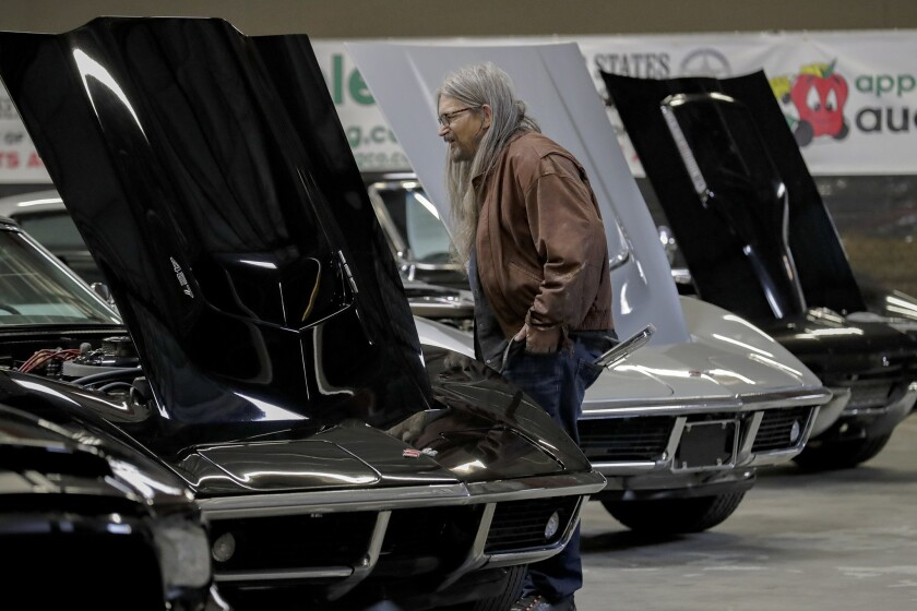 Alan Moskovitz, 65, checks out Corvettes on the auction block at Apple Auctioneering Co., which manages government assets and auctions them off online.